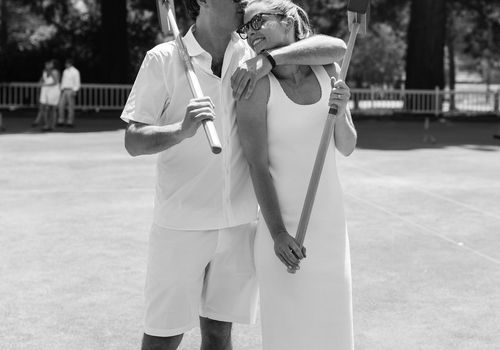 <p>bride and groom playing croquet</p>