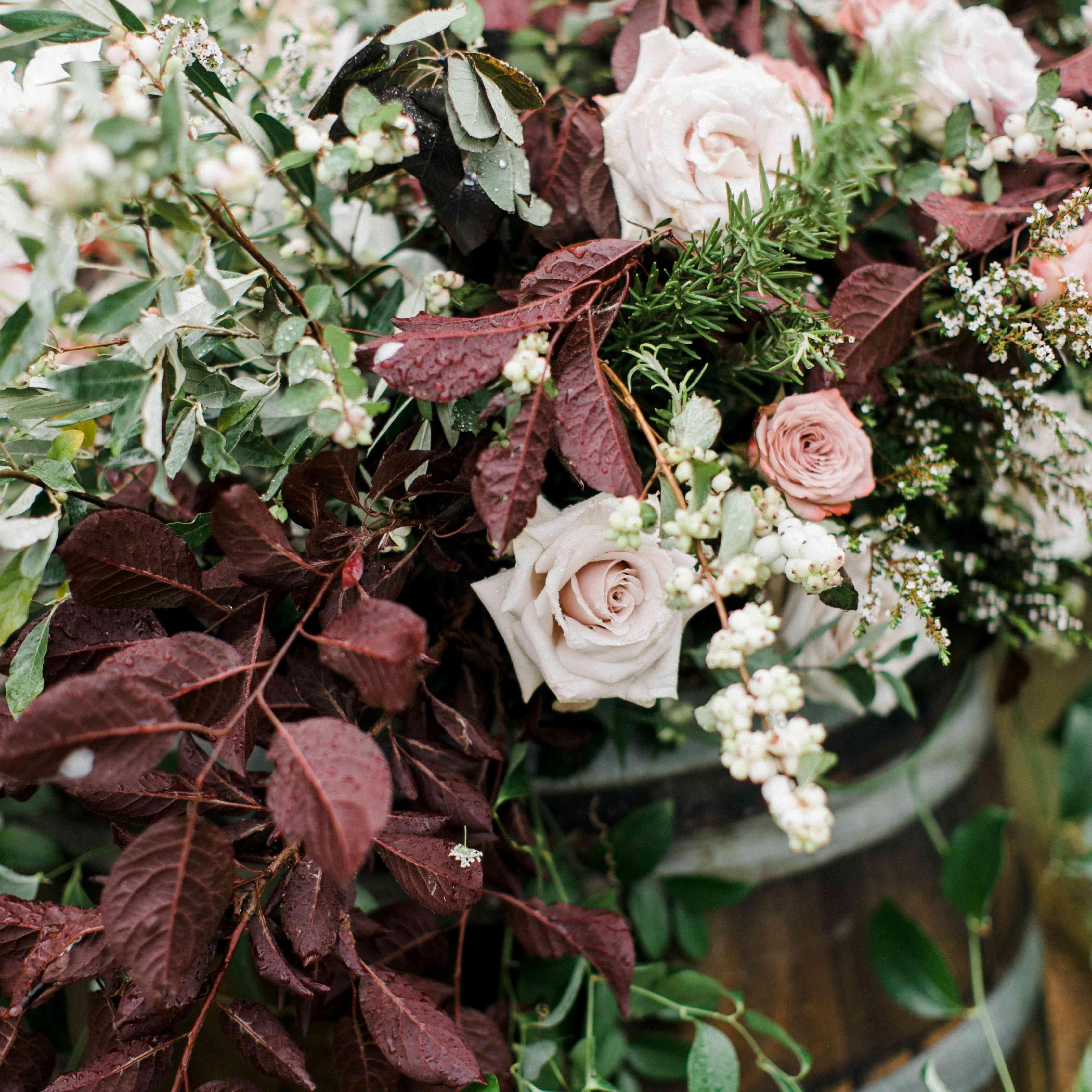 A floral arrangement on a barrel