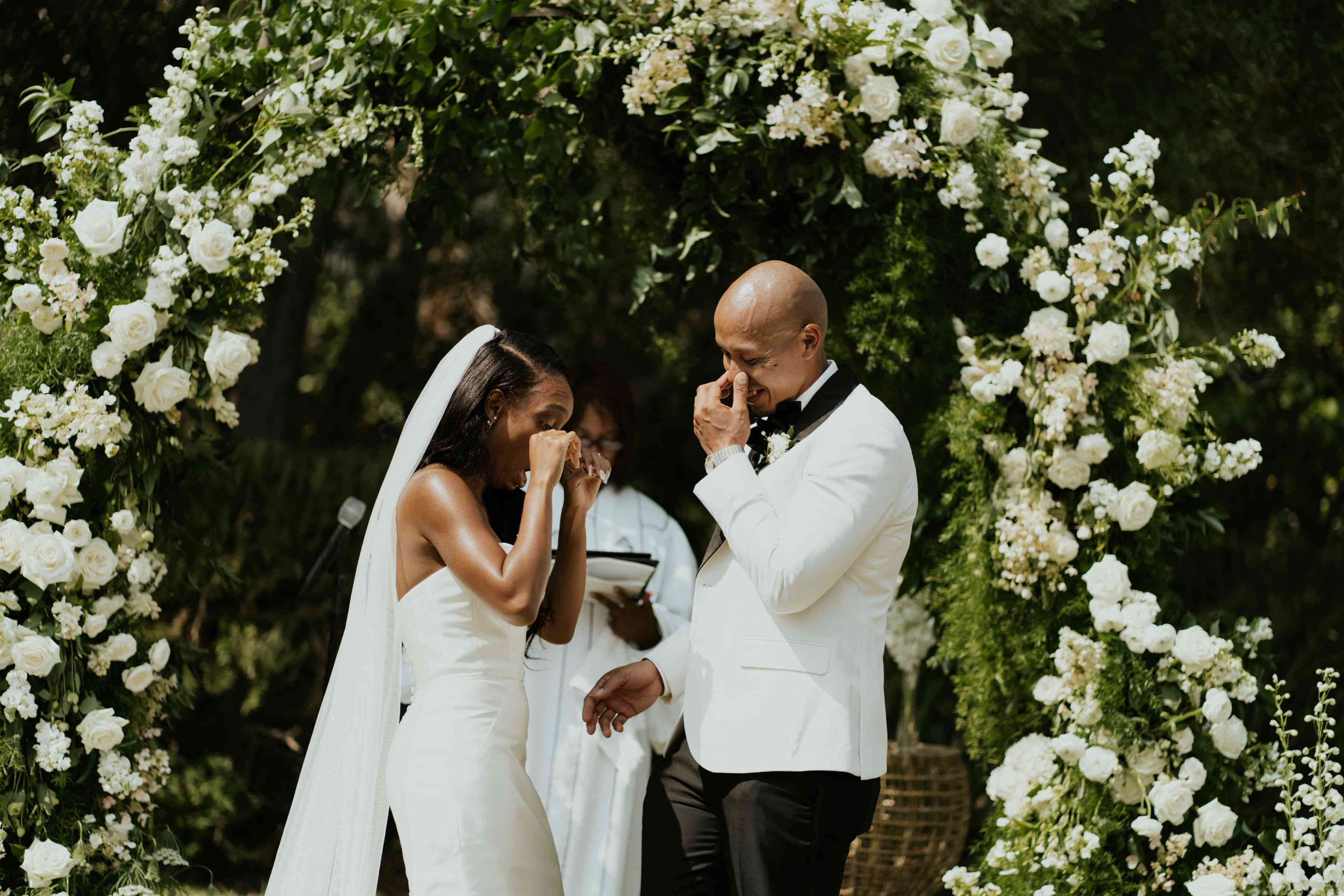 Bride and groom both crying at the wedding altar
