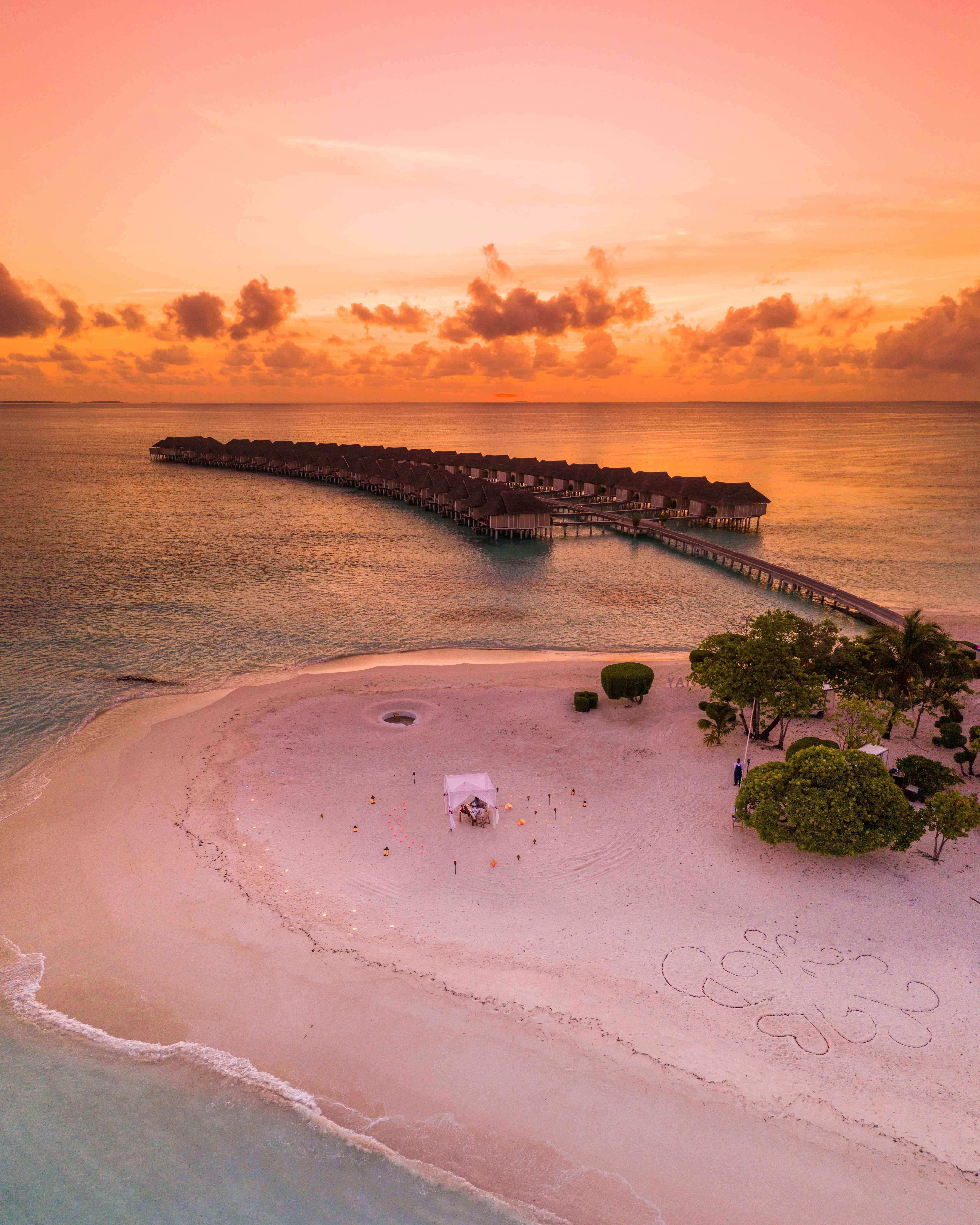 beachside villas at sunset
