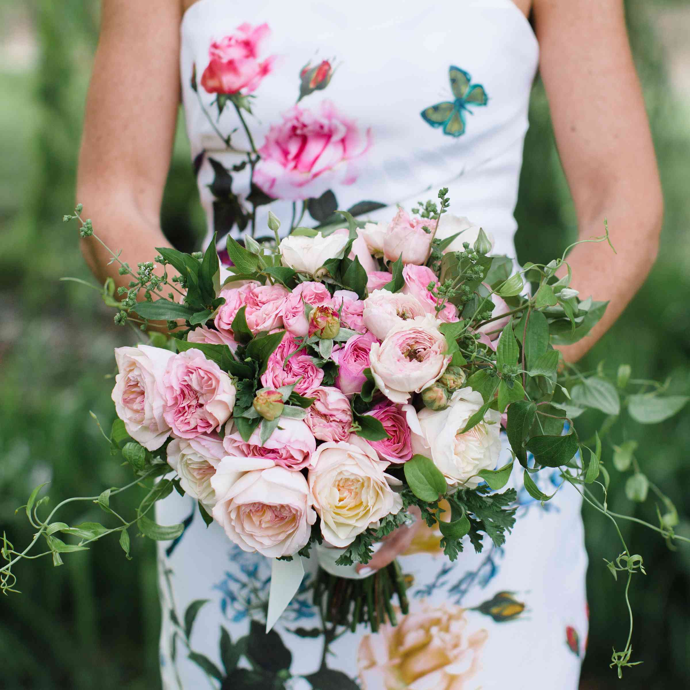 floral printed wedding dress with bouquet