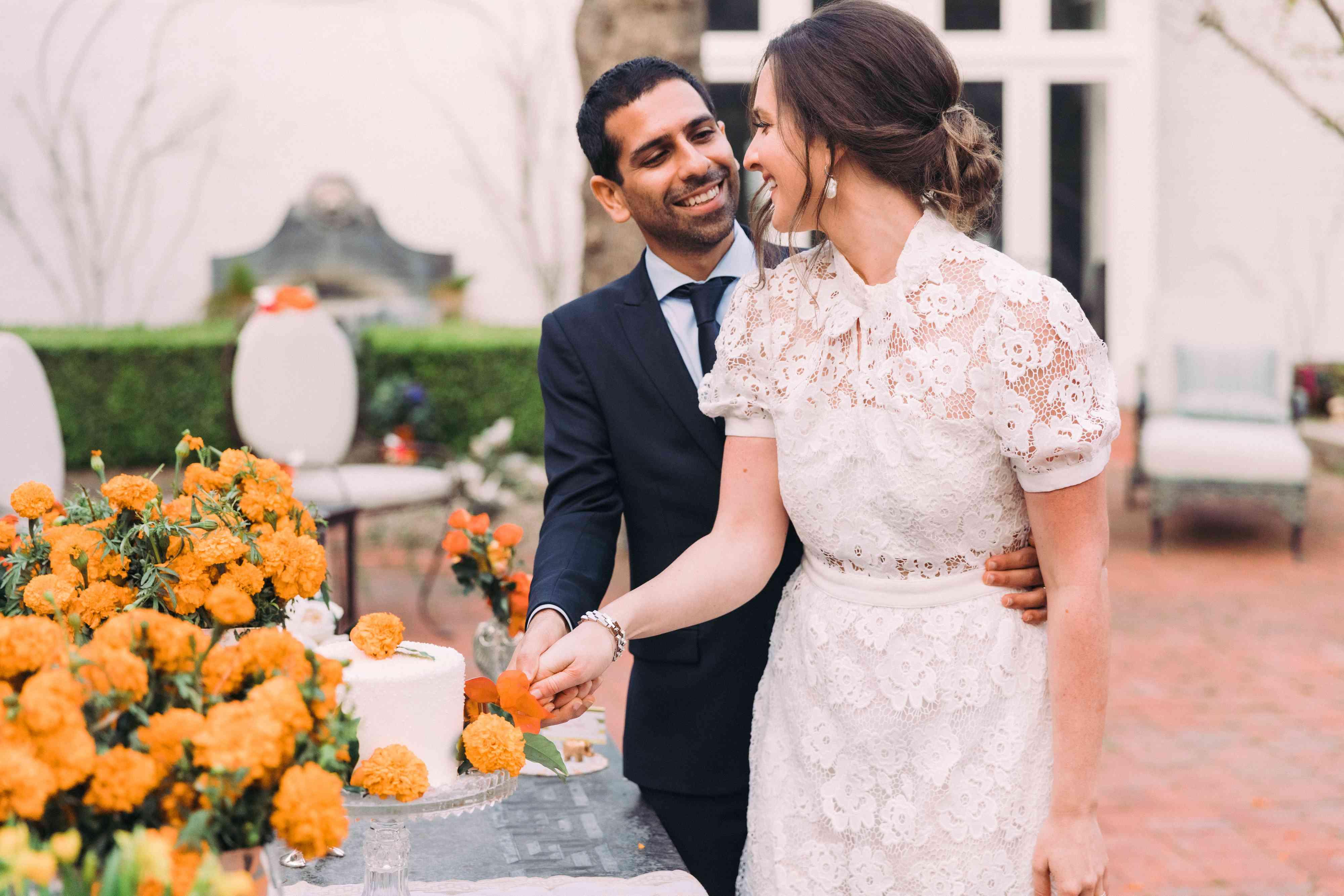 couple cutting cake