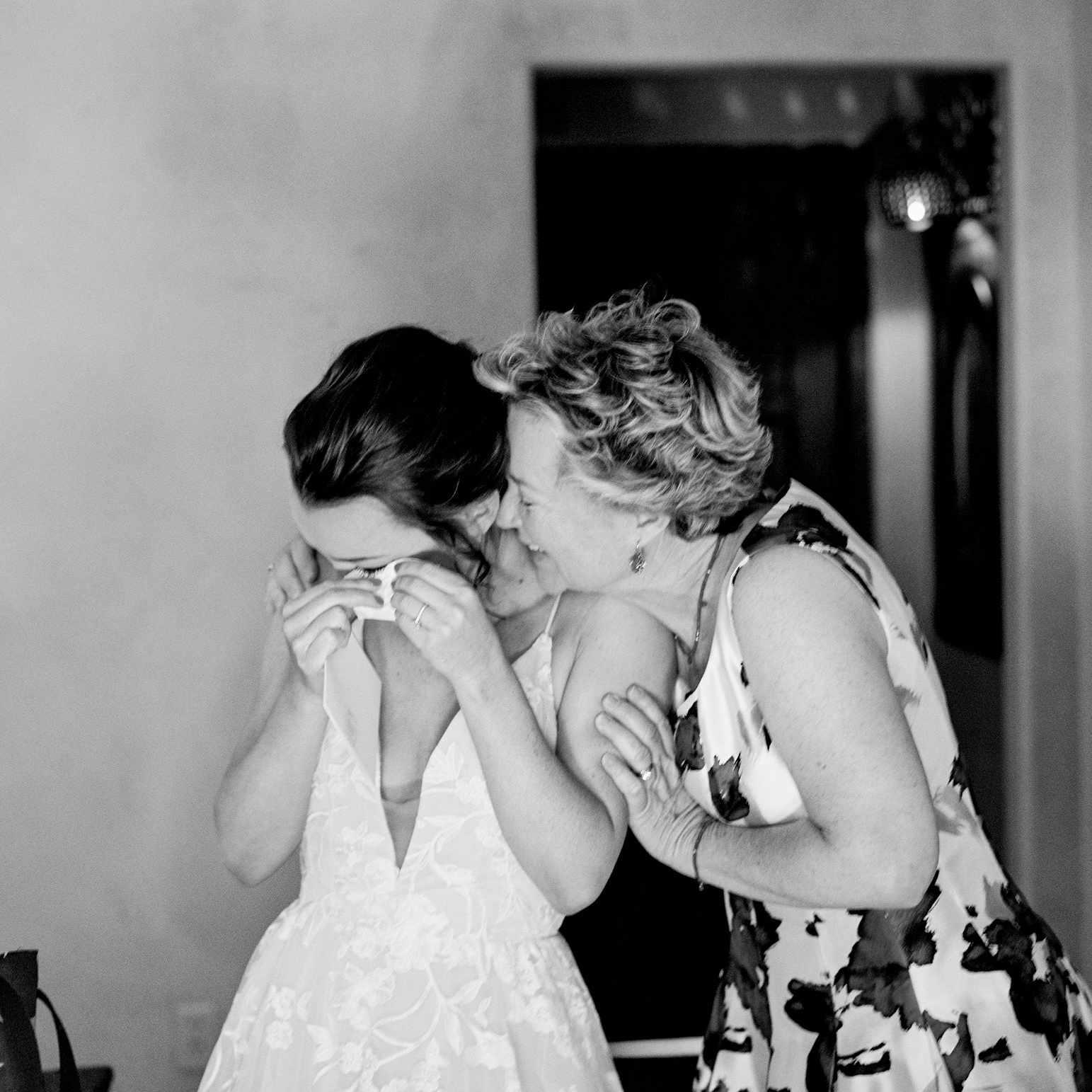 mom and bride embracing