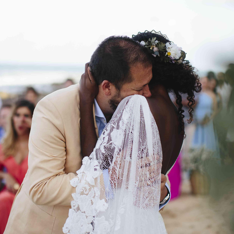 bride and groom emotional hugging