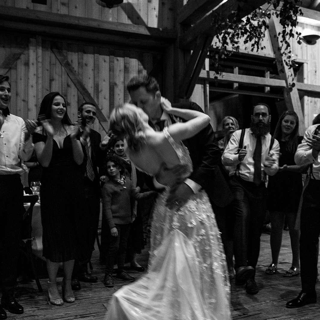 couple kissing on dance floor
