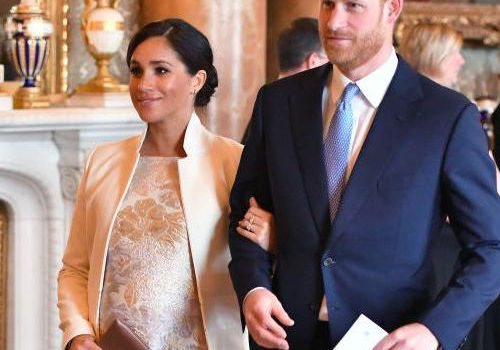Meghan Markle and Prince Harry attend a royal event at Buckingham Palace.
