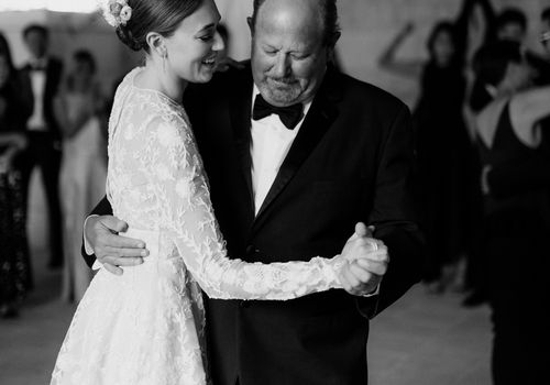Bride dancing with her father during the father-daughter dance at her wedding