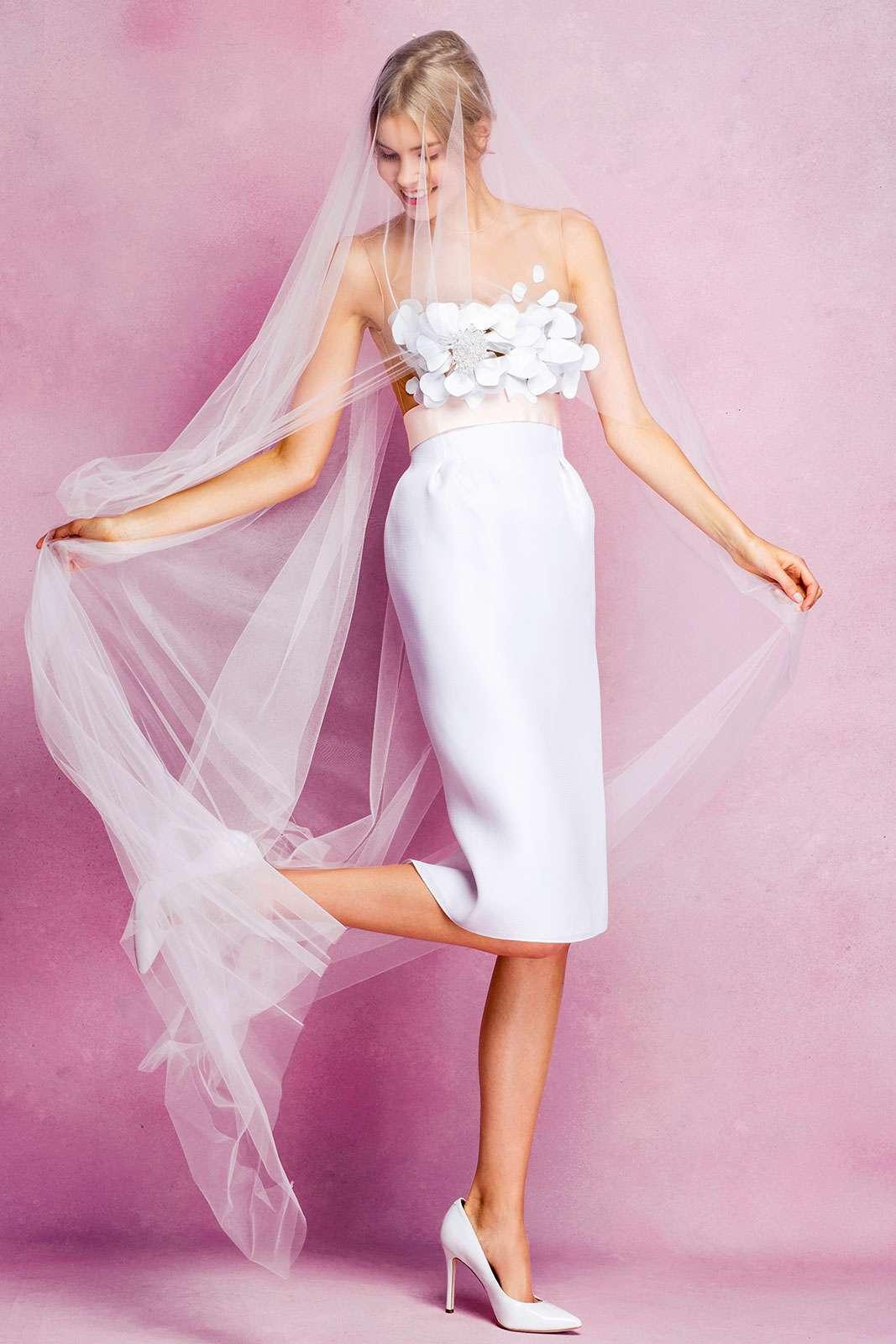 bride wearing tea-length dress and veil