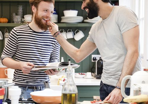 <p>Newlyweds Cooking Together at Home</p>