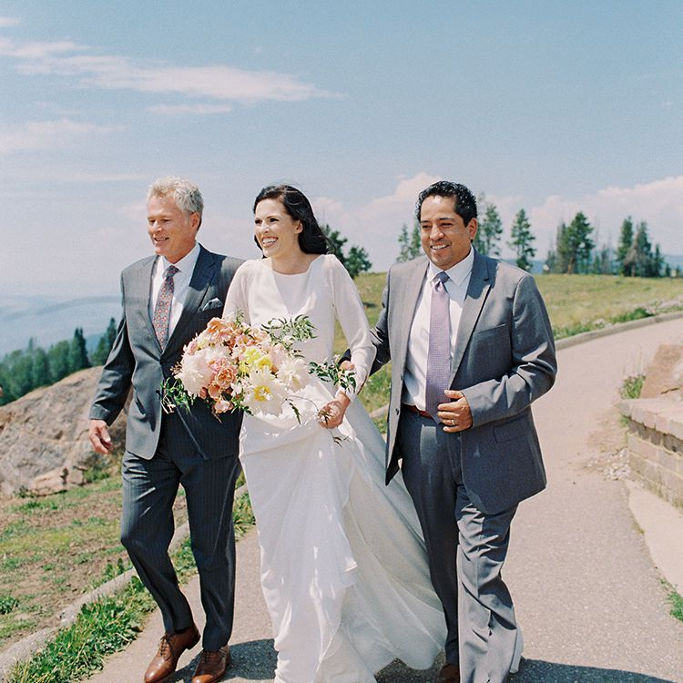bride with father and stepfather