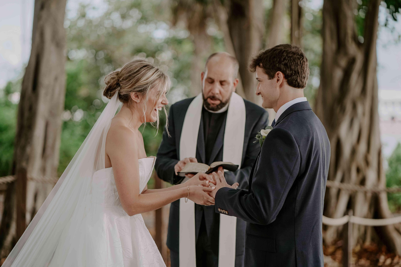bride and groom at wedding altar