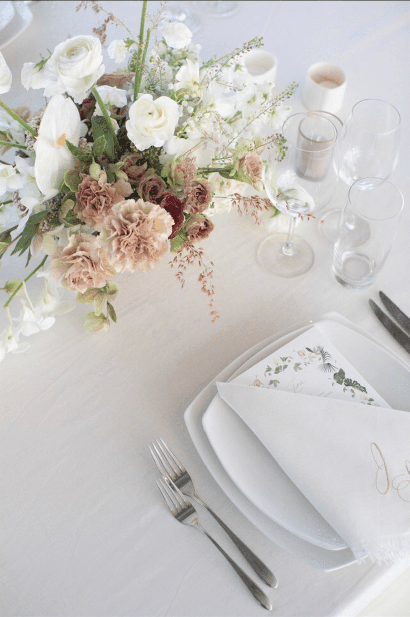 reception tabletop with menu and flowers
