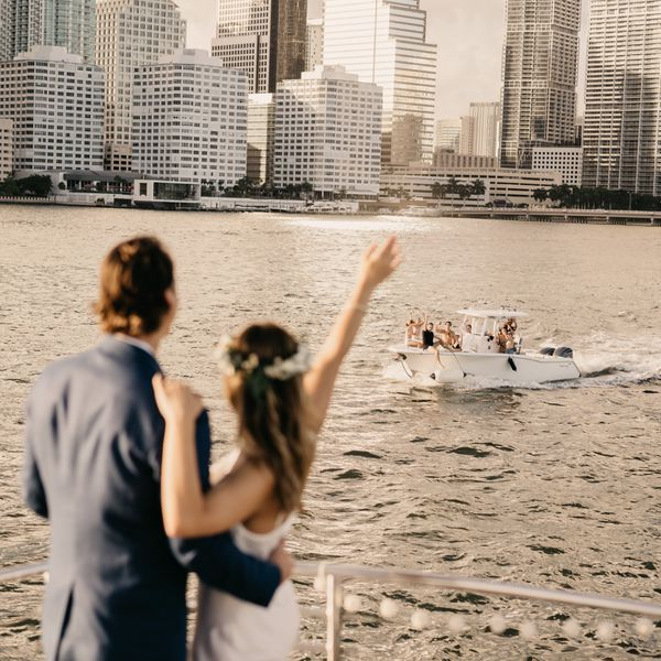 couple waving to boat