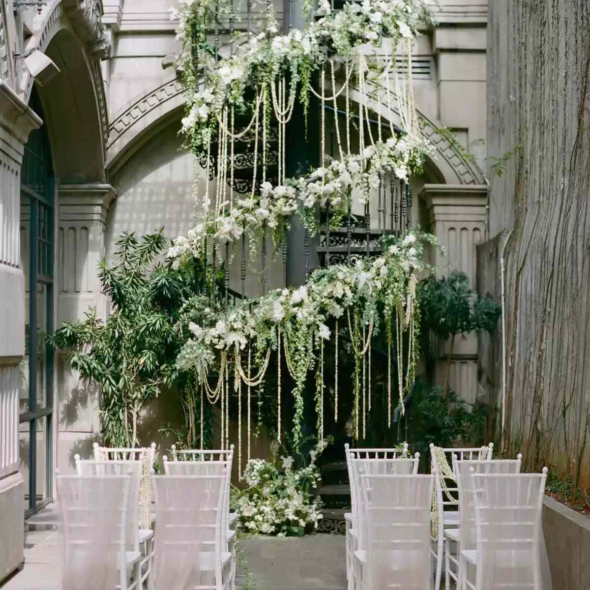 Asymmetrical hanging greenery altar