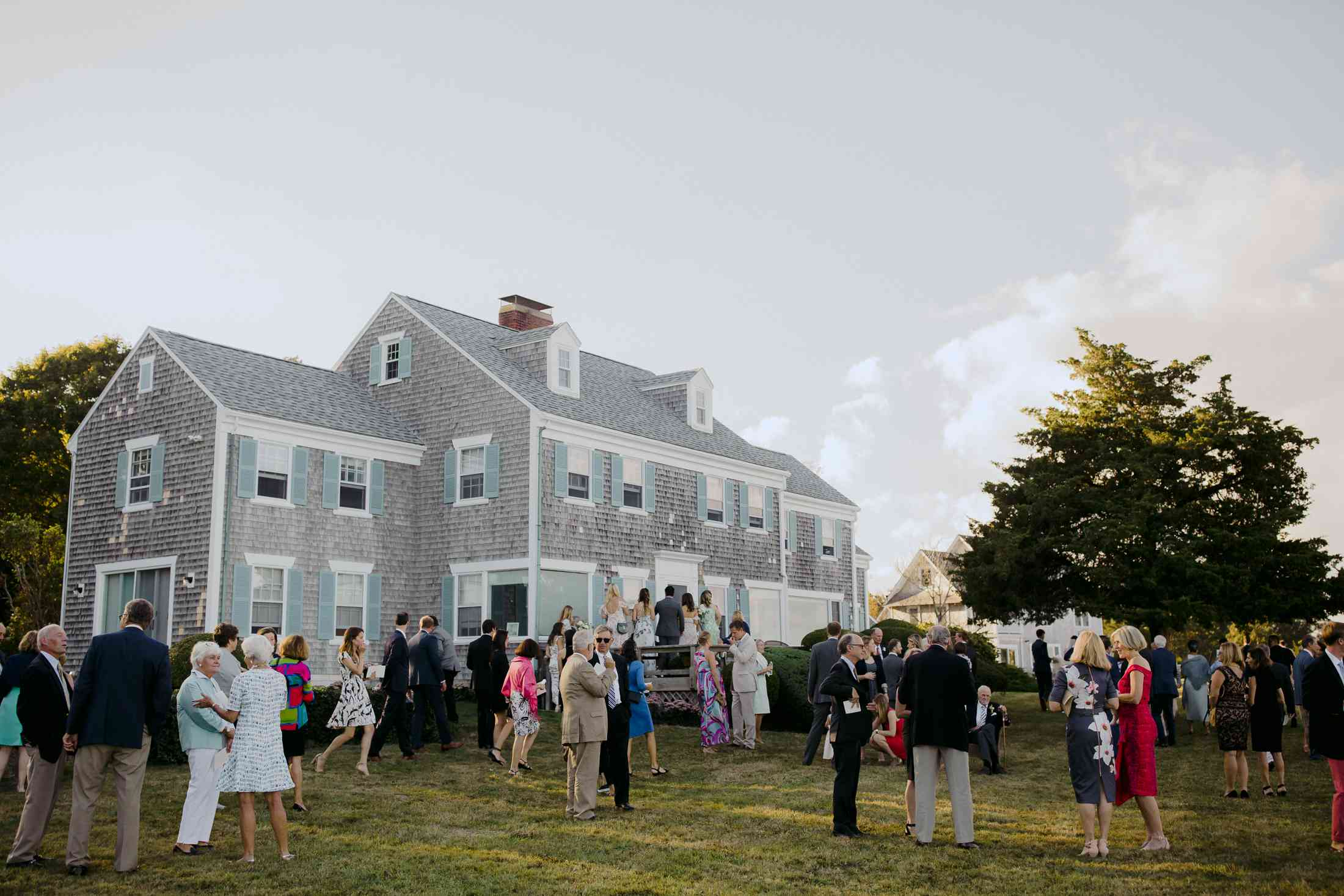 at-home rustic massachusetts wedding, guests mingling outside