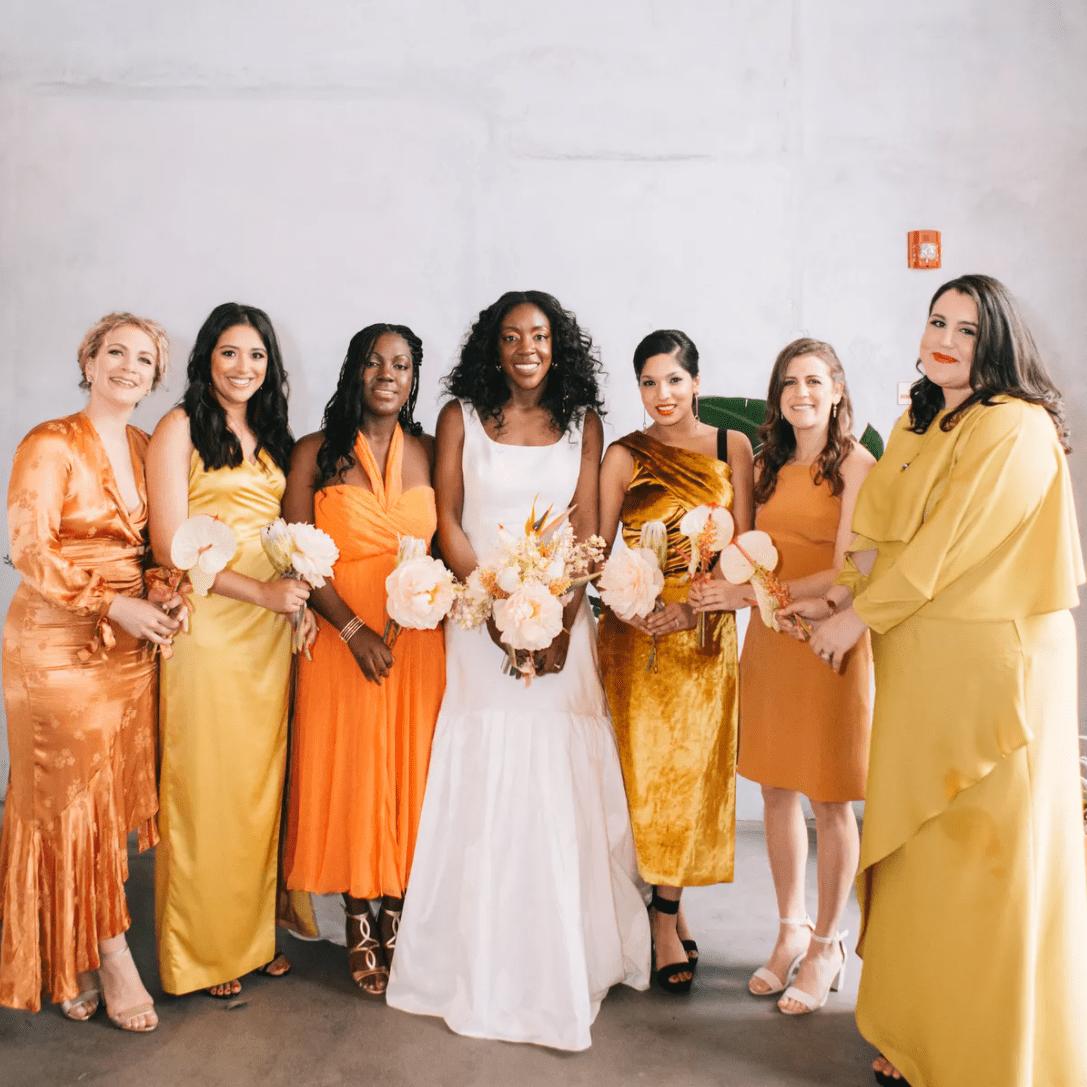 Bride with bridesmaids in citrus tones