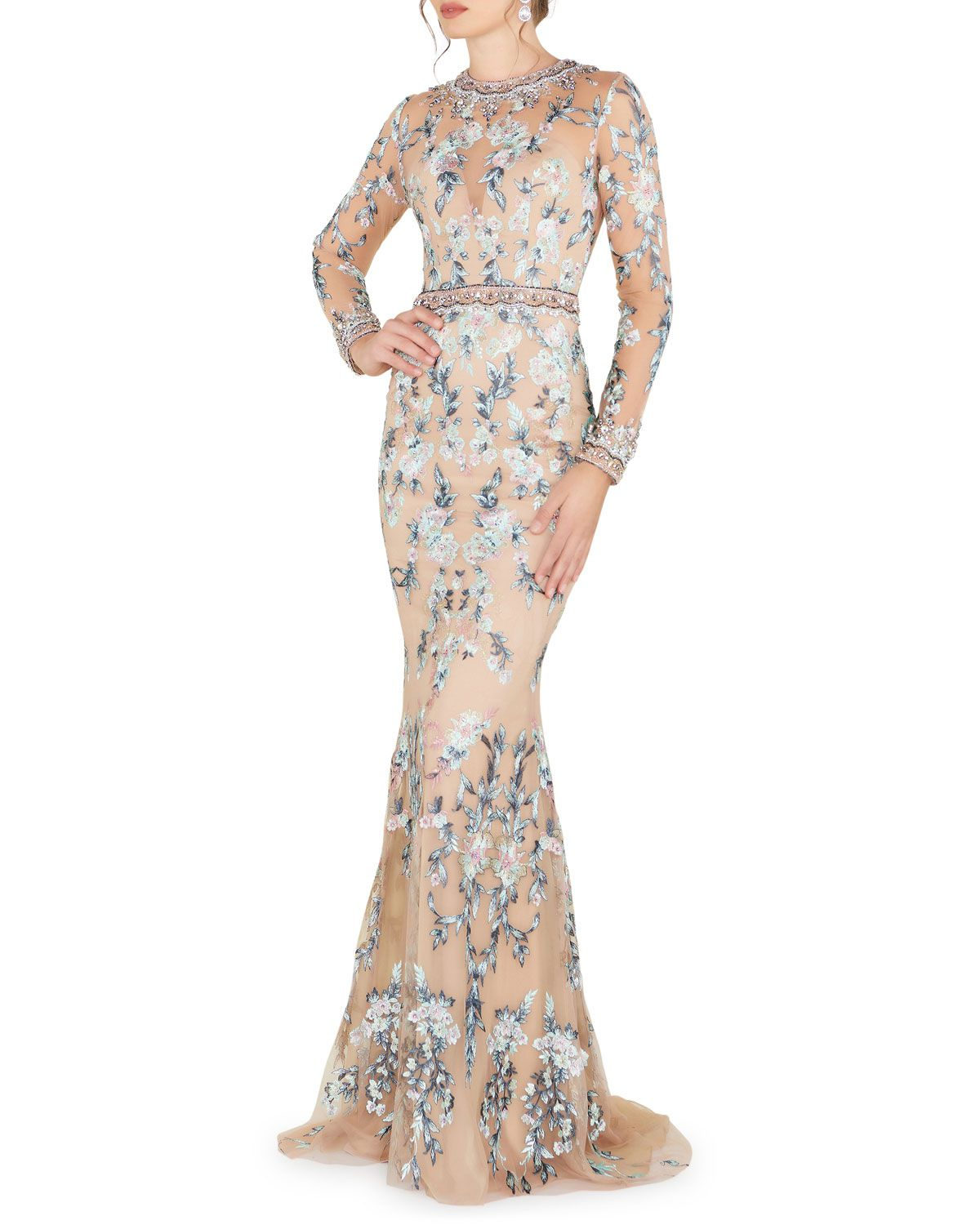 Model in floral-embroidered sheer tulle lace gown