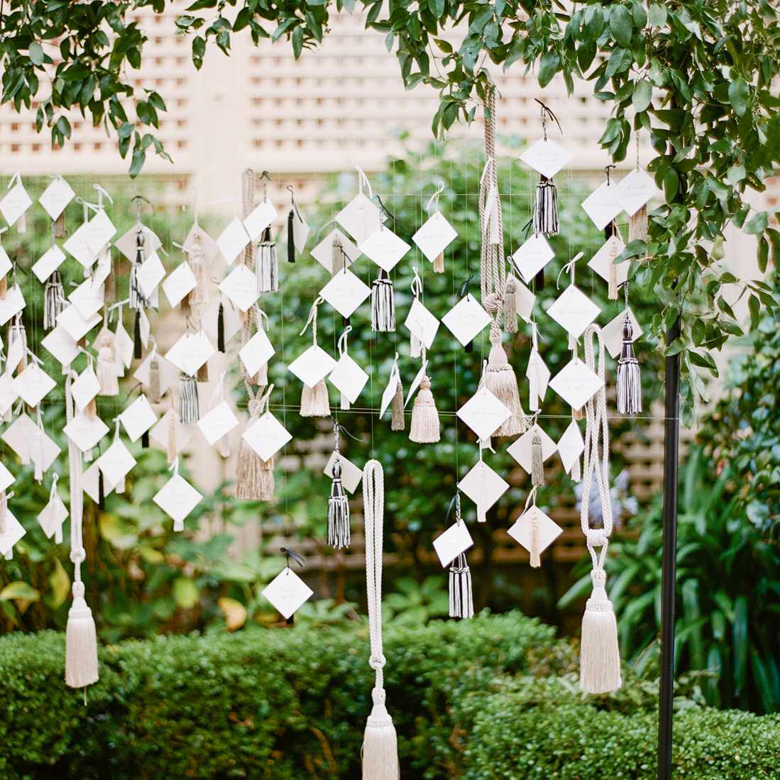 hanging escort card display with tassels