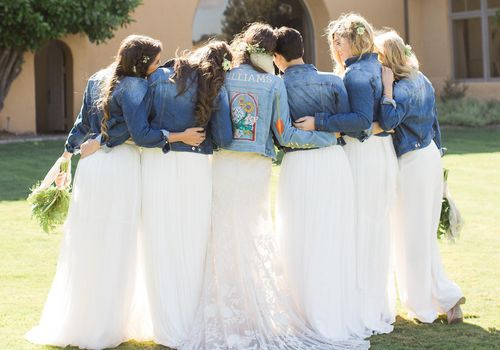 Bride with bridesmaids in jean jackets