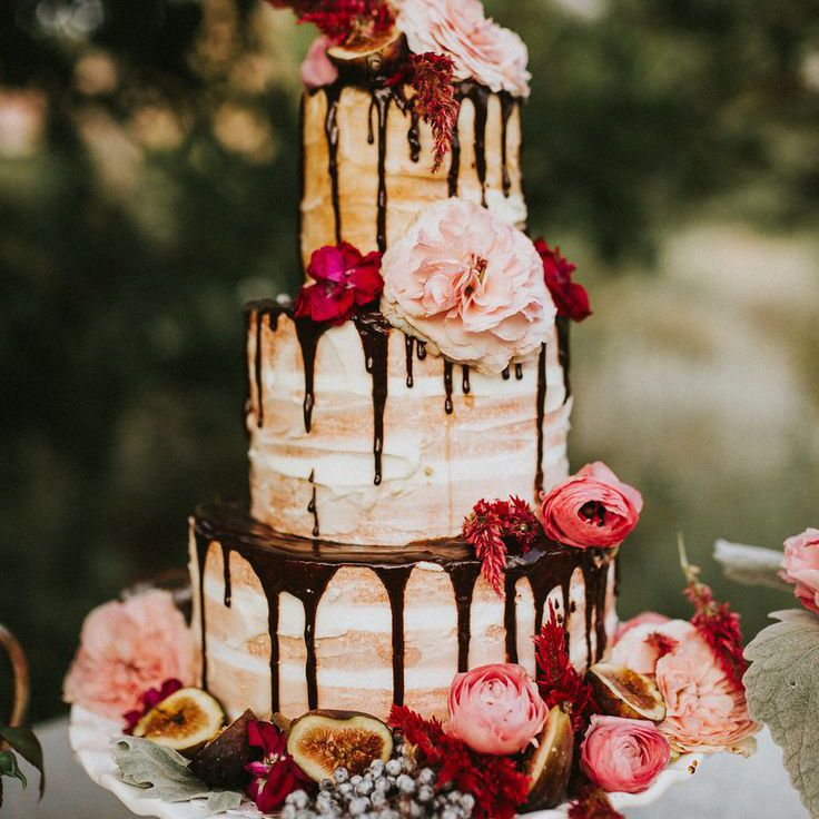 Naked cake with chocolate drip and pink florals