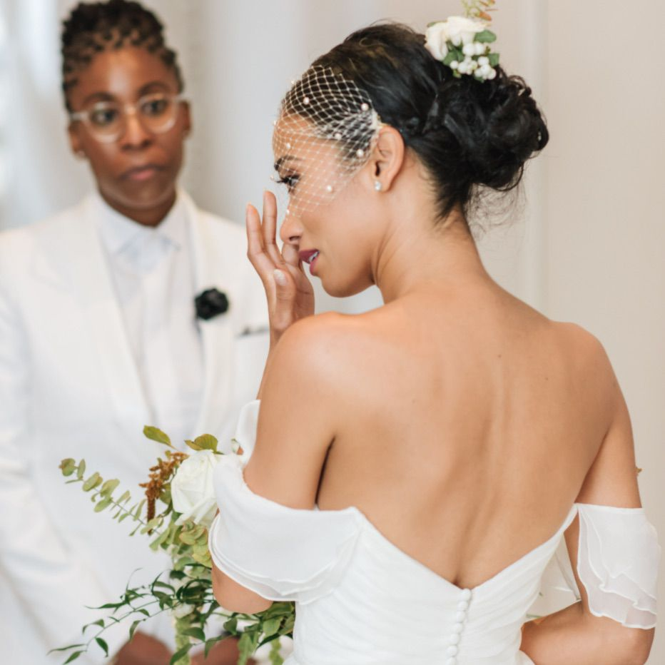 Bride wiping away tears during vow exchange