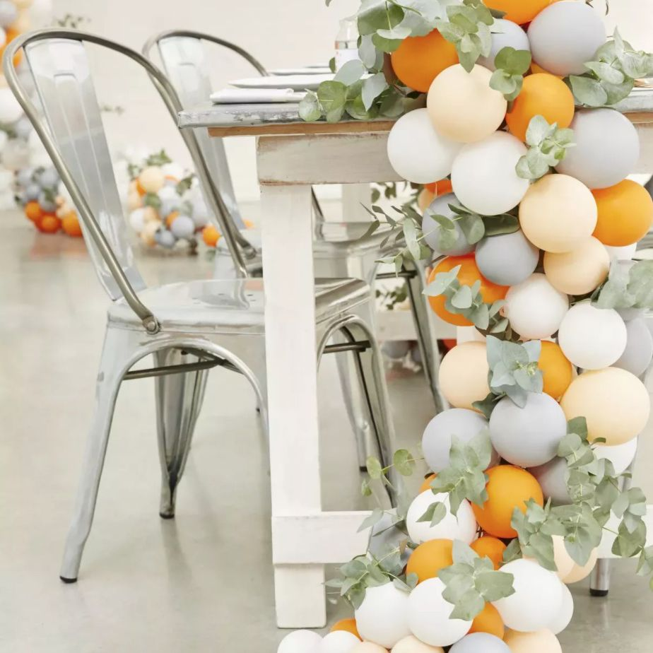 Sweetheart table with balloons and eucalyptus