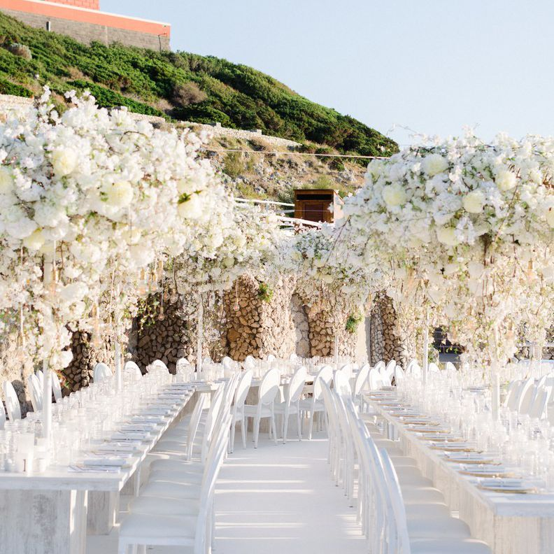 Massive cascading white floral installations at reception