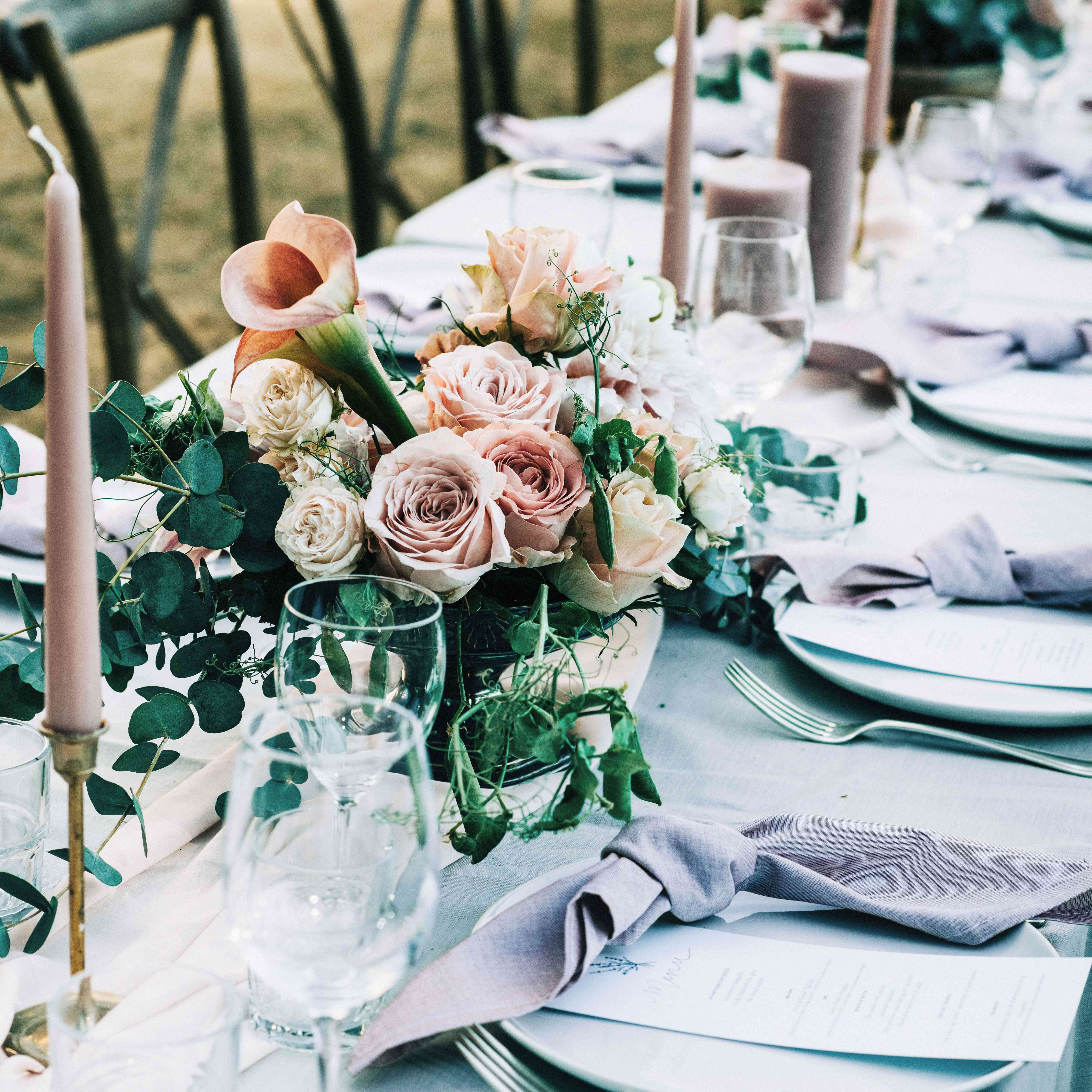 tablescape colored taper candles flowers