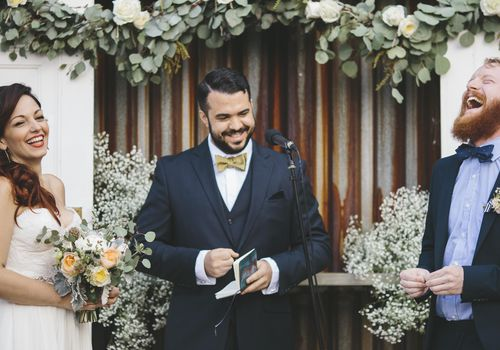 <p>Bride and Groom Laughing During Wedding Vows</p>