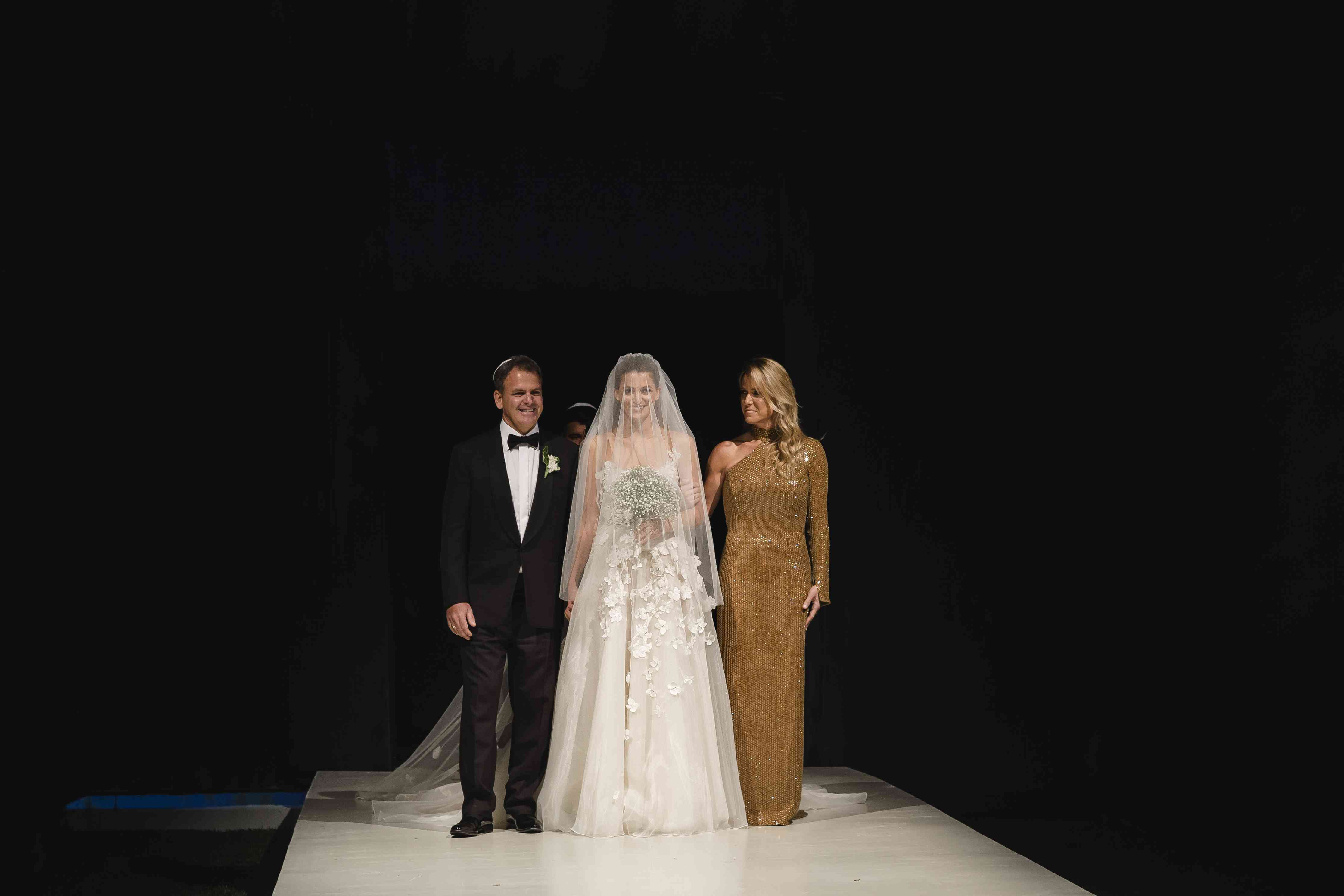<p>Bride and groom with parents</p><br><br>