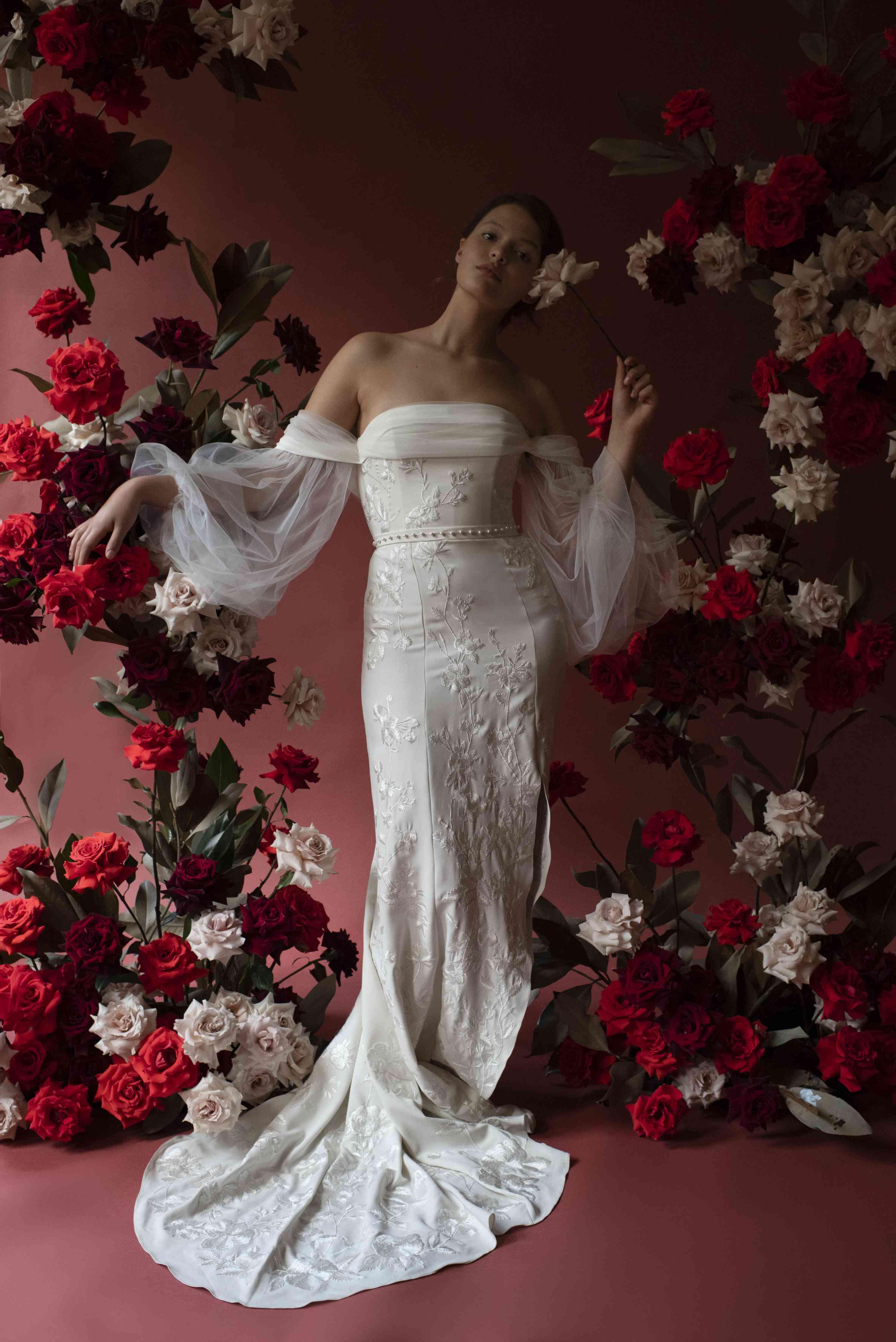 Model in off-the-shoulder voluminous sleeve wedding dress