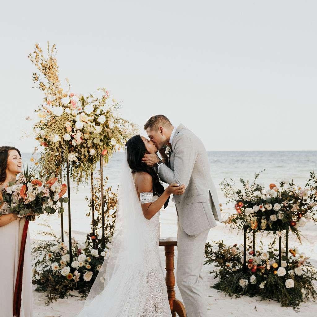 The couple kisses