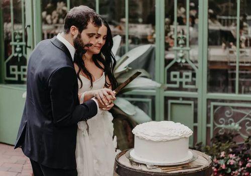 Bride and Groom Cutting Cake at Garden Wedding