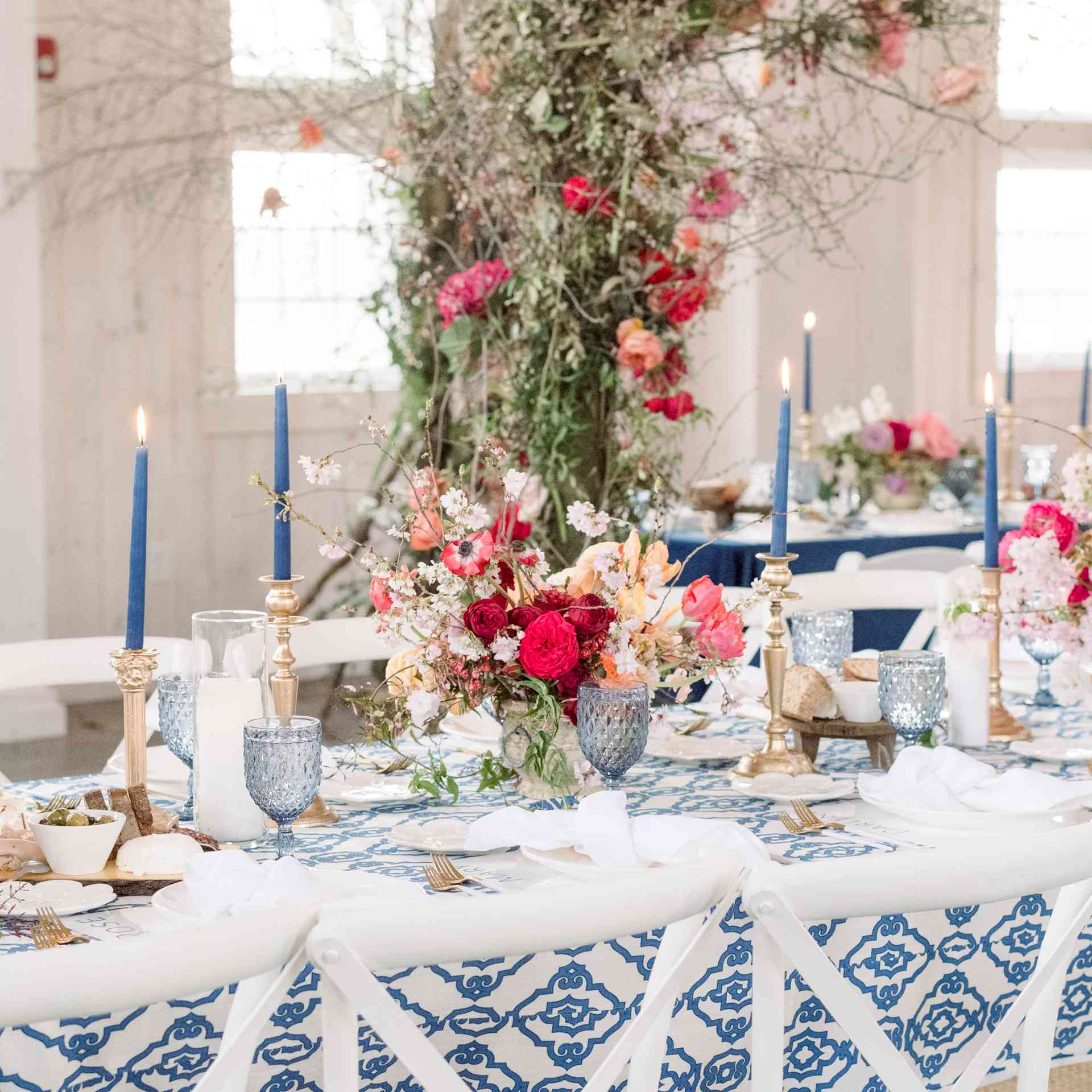 Navy taper candles on blue and white tablecloth