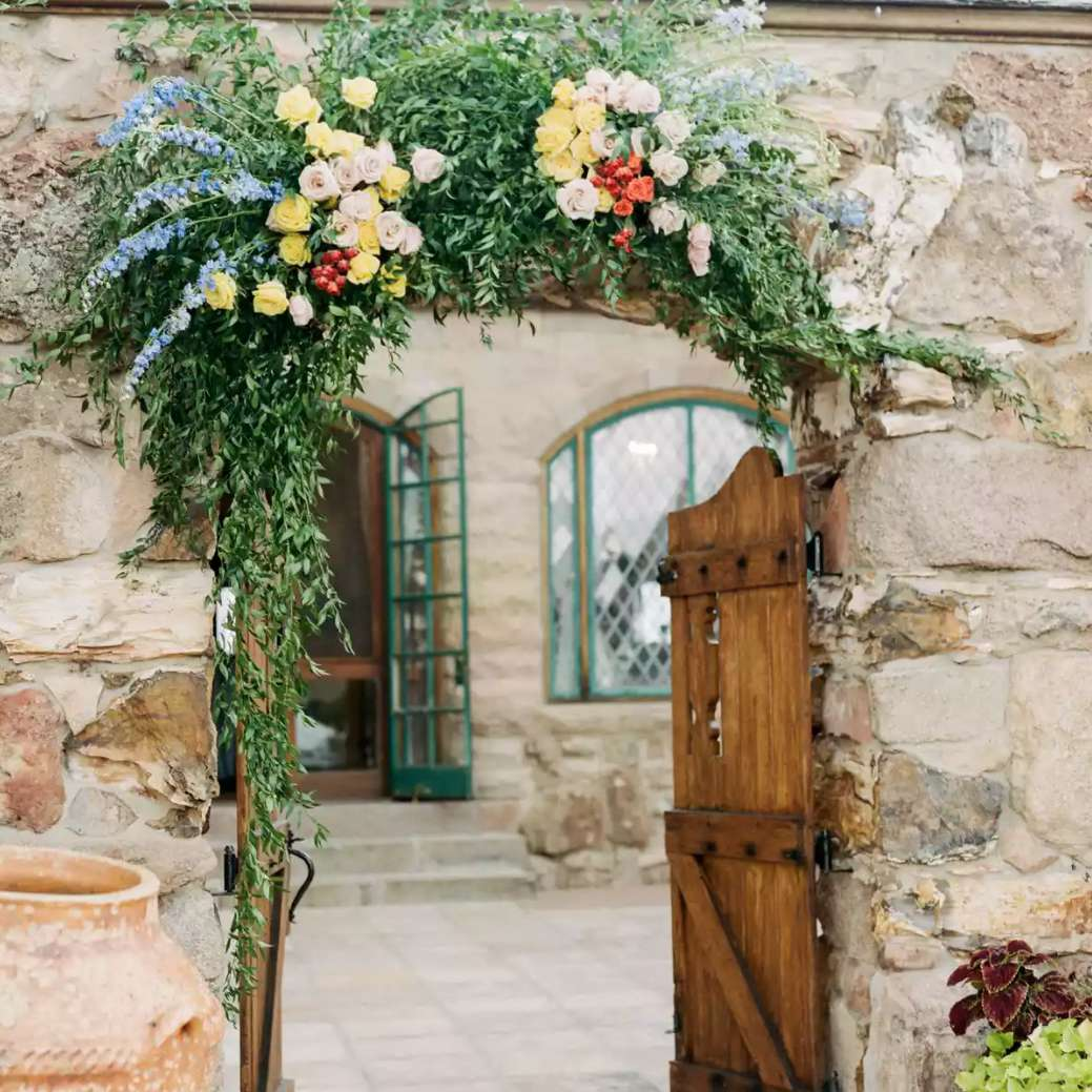Colorful floral arch over entryway