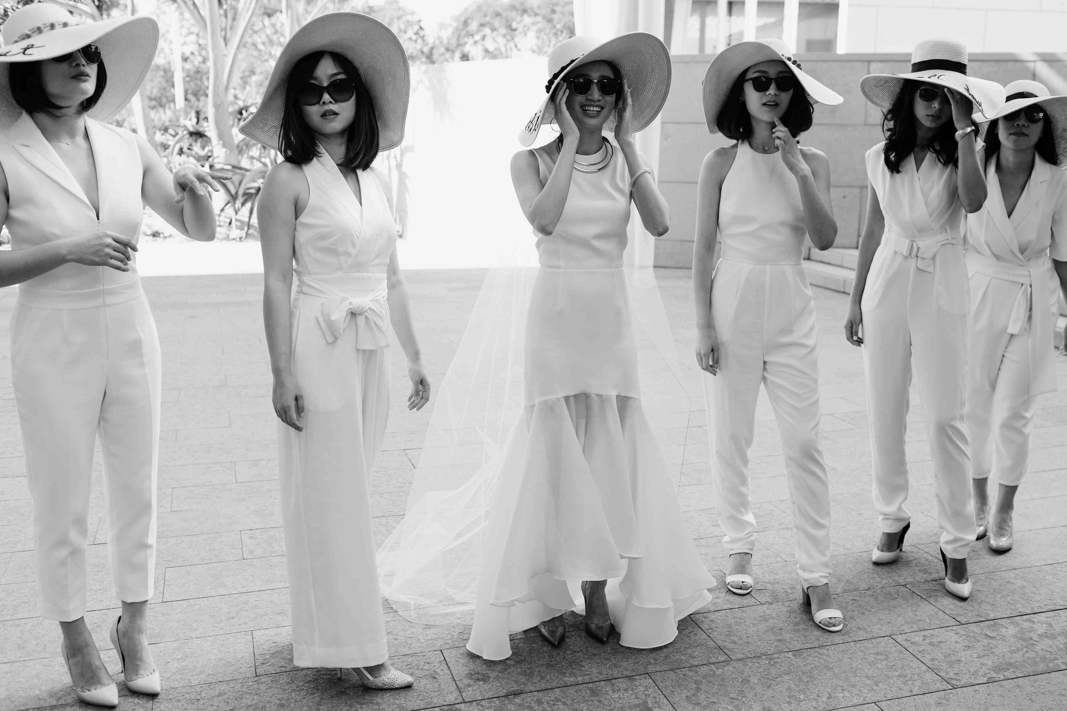 Bride with bridesmaids in hats