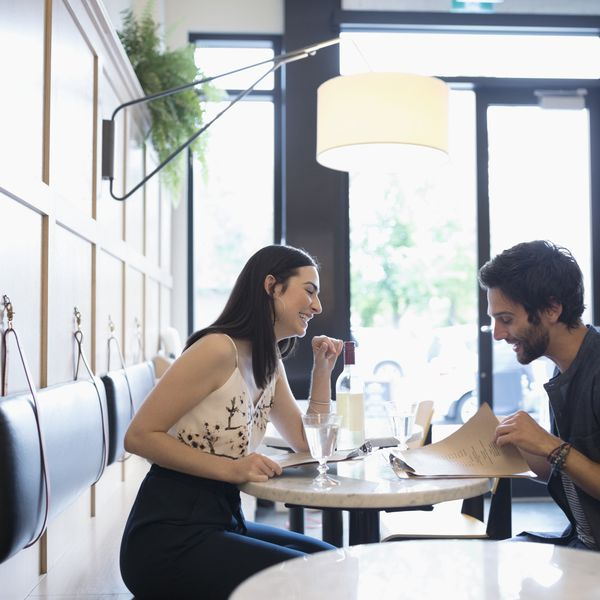 Couple on date at restaurant smiling and talking
