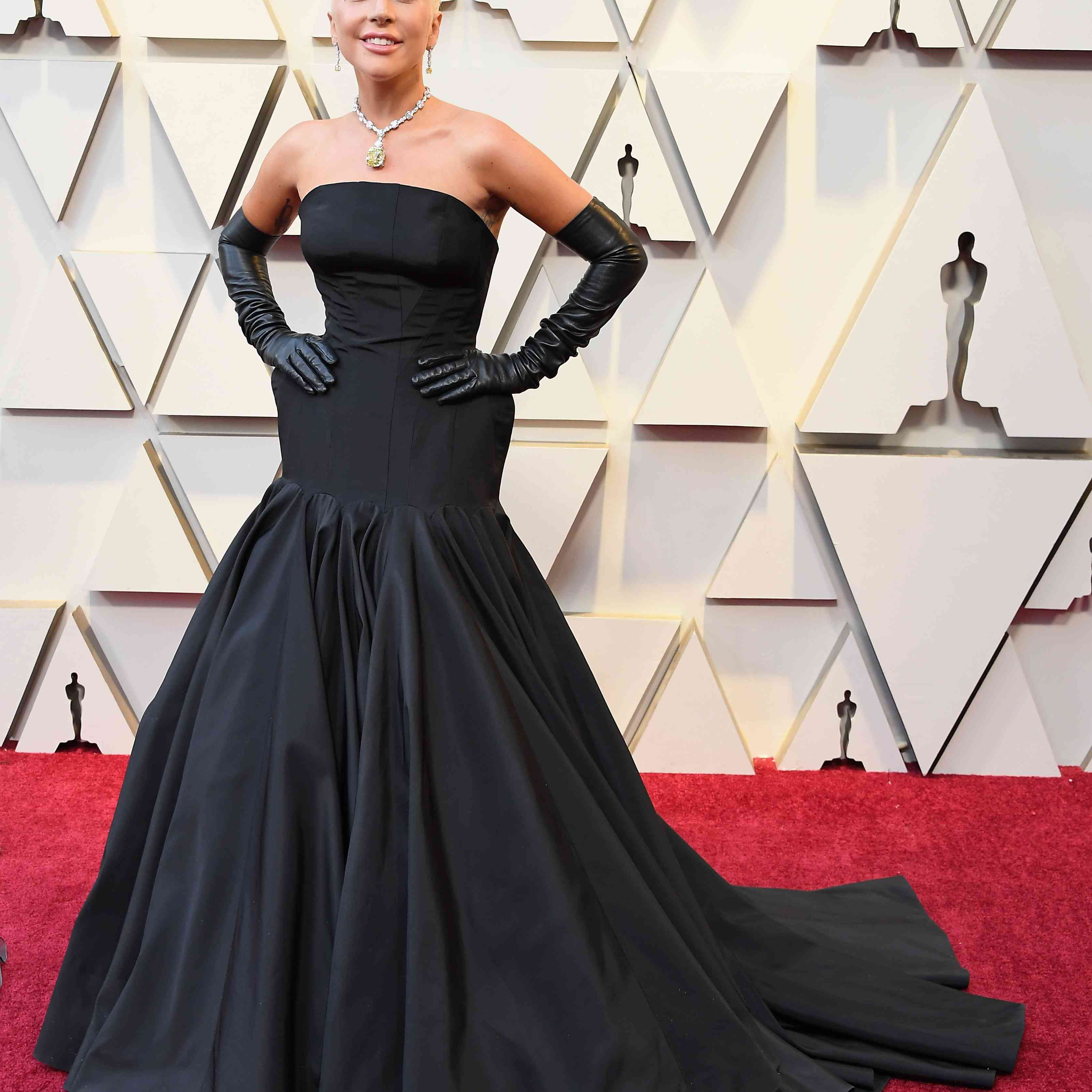 Lady Gagy in black gown and Tiffany diamond necklace on red carpet