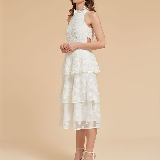 Frilly sleeveless wedding gown