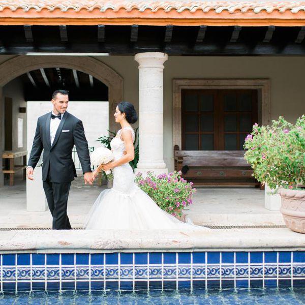 Bride and groom near pool