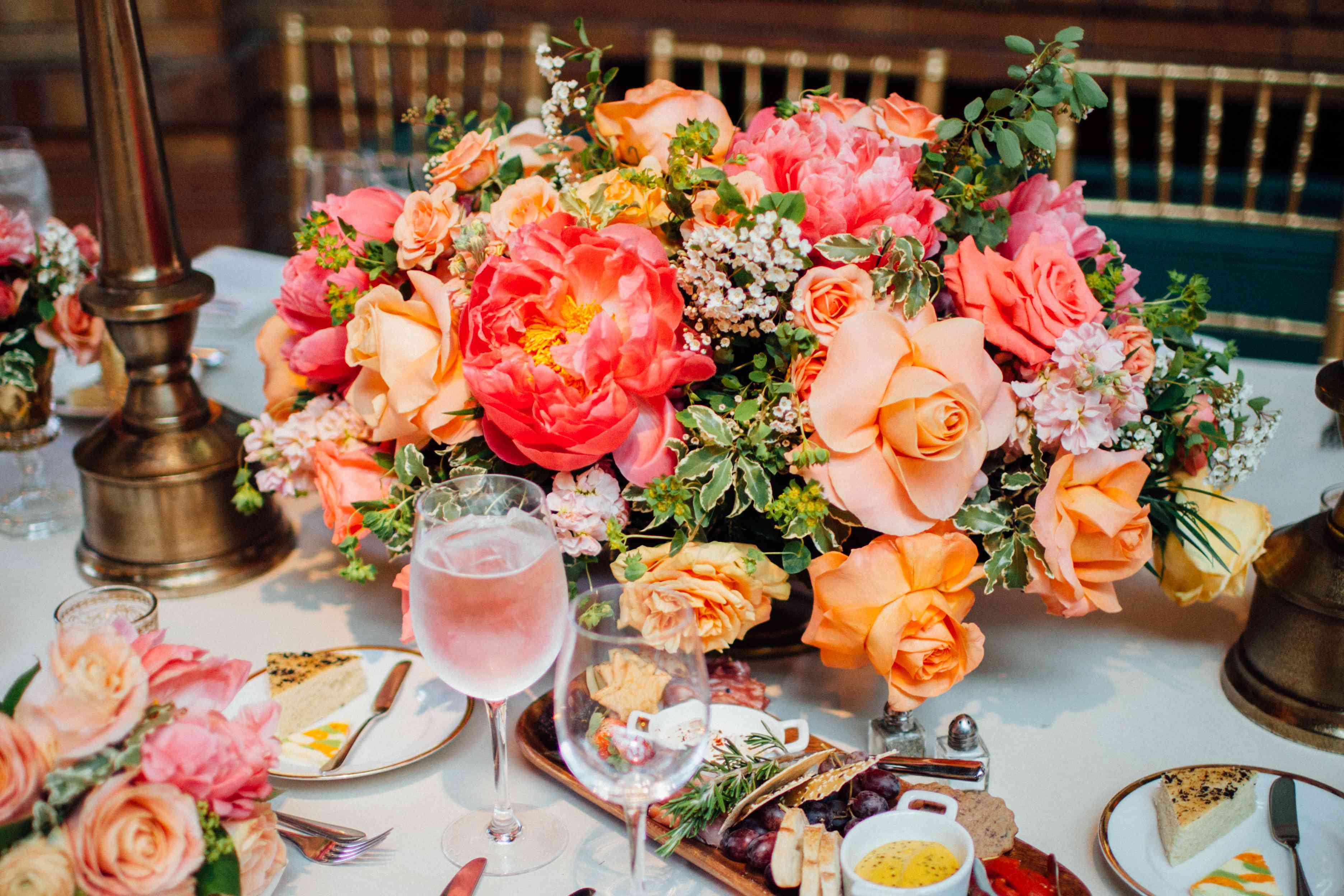<p>Peach Peony and Rose Centerpiece</p><br><br>