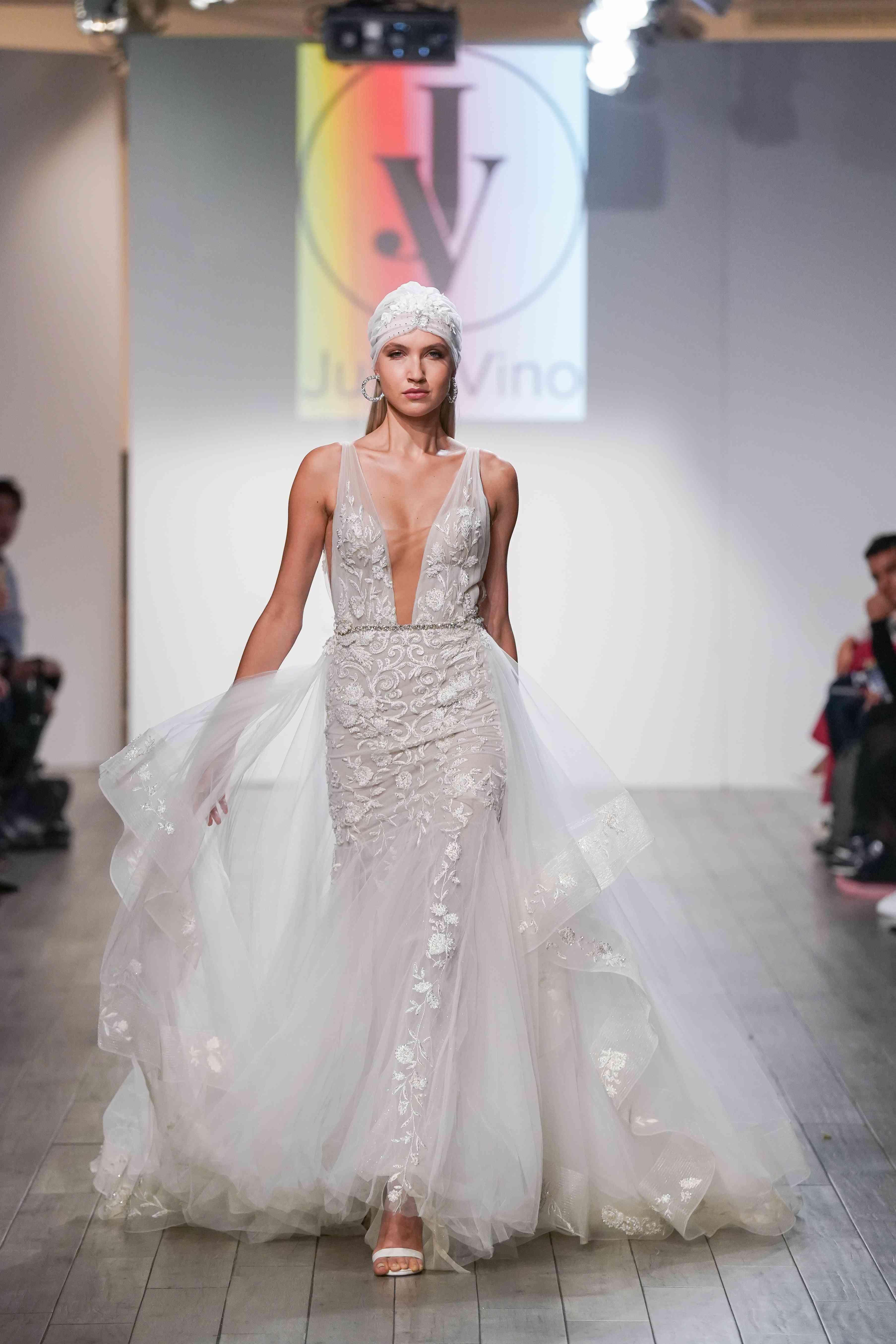 Model in plunging mermaid wedding dress