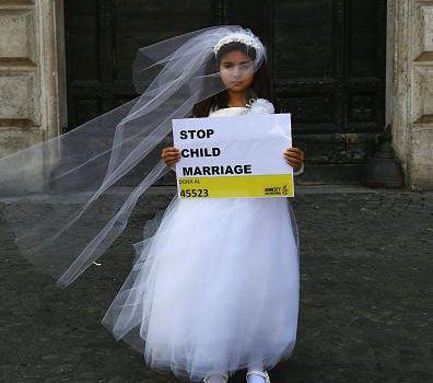 child bride in wedding gown