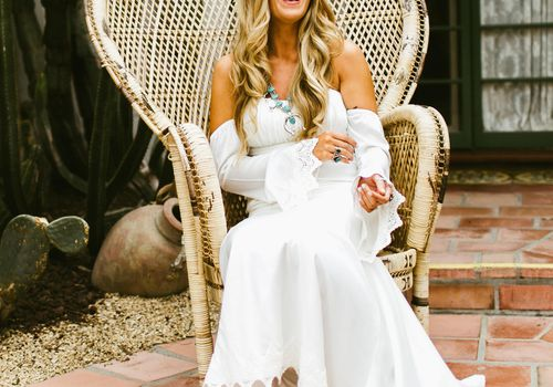 Bride sitting in a chair laughing