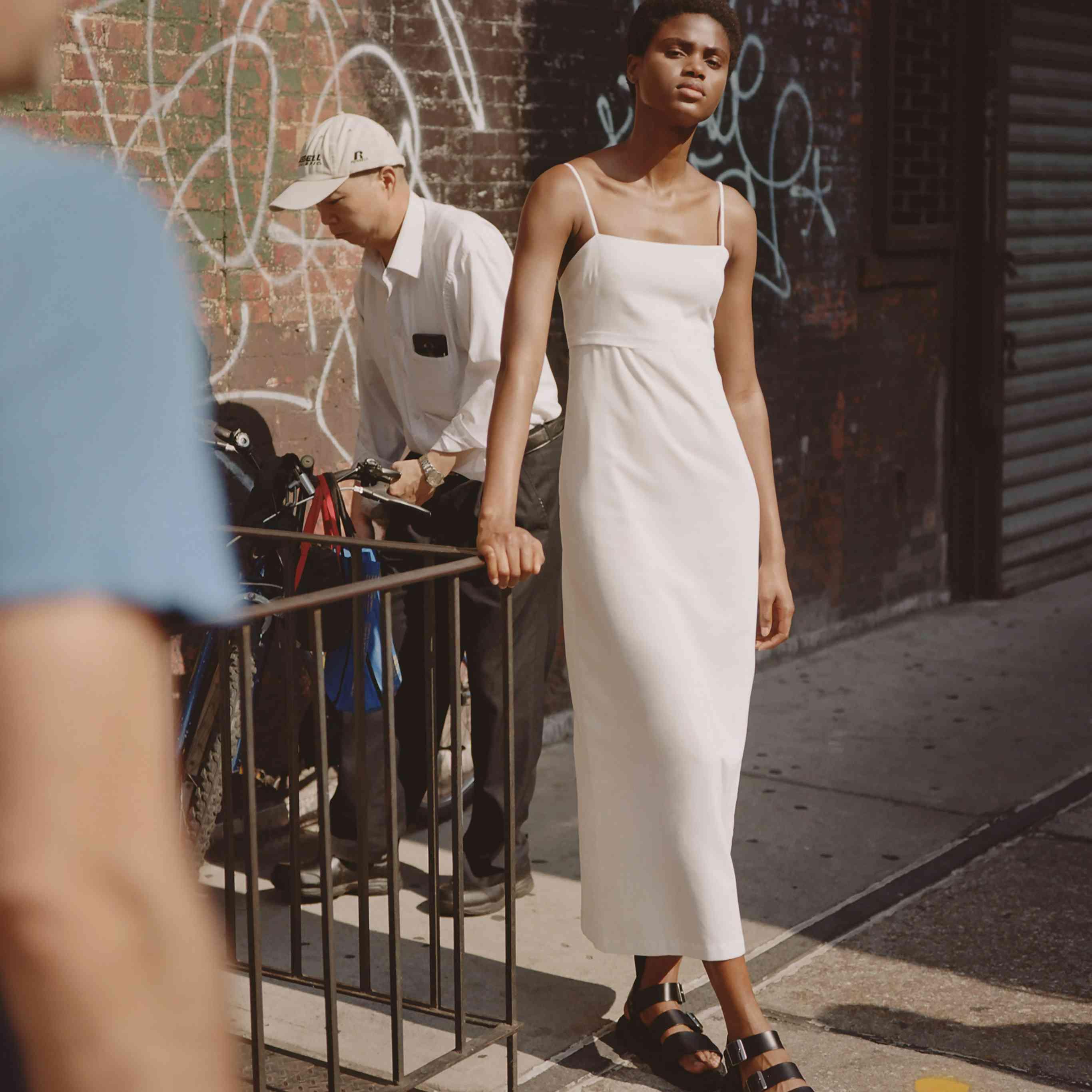 Model in slip midi wedding dress