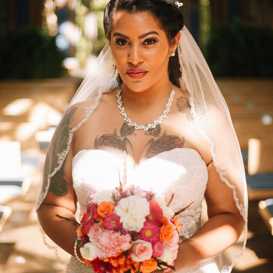 Tattooed bride wearing a strapless wedding dress