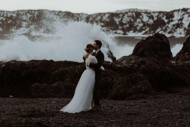 Couple kissing at Djúpalónssandur Beach in Iceland