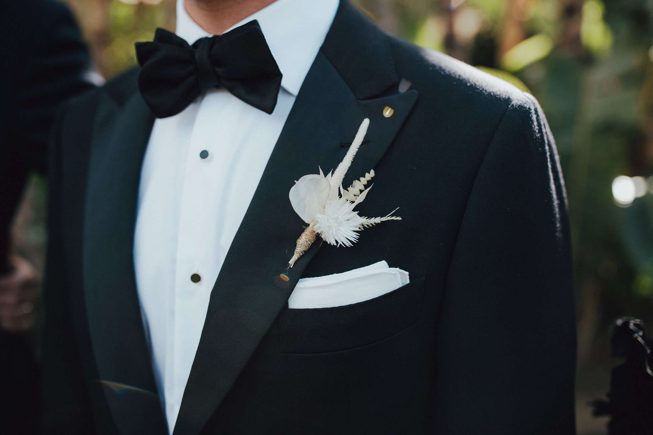 Bleached dried grass and chrysanthemum boutonniere