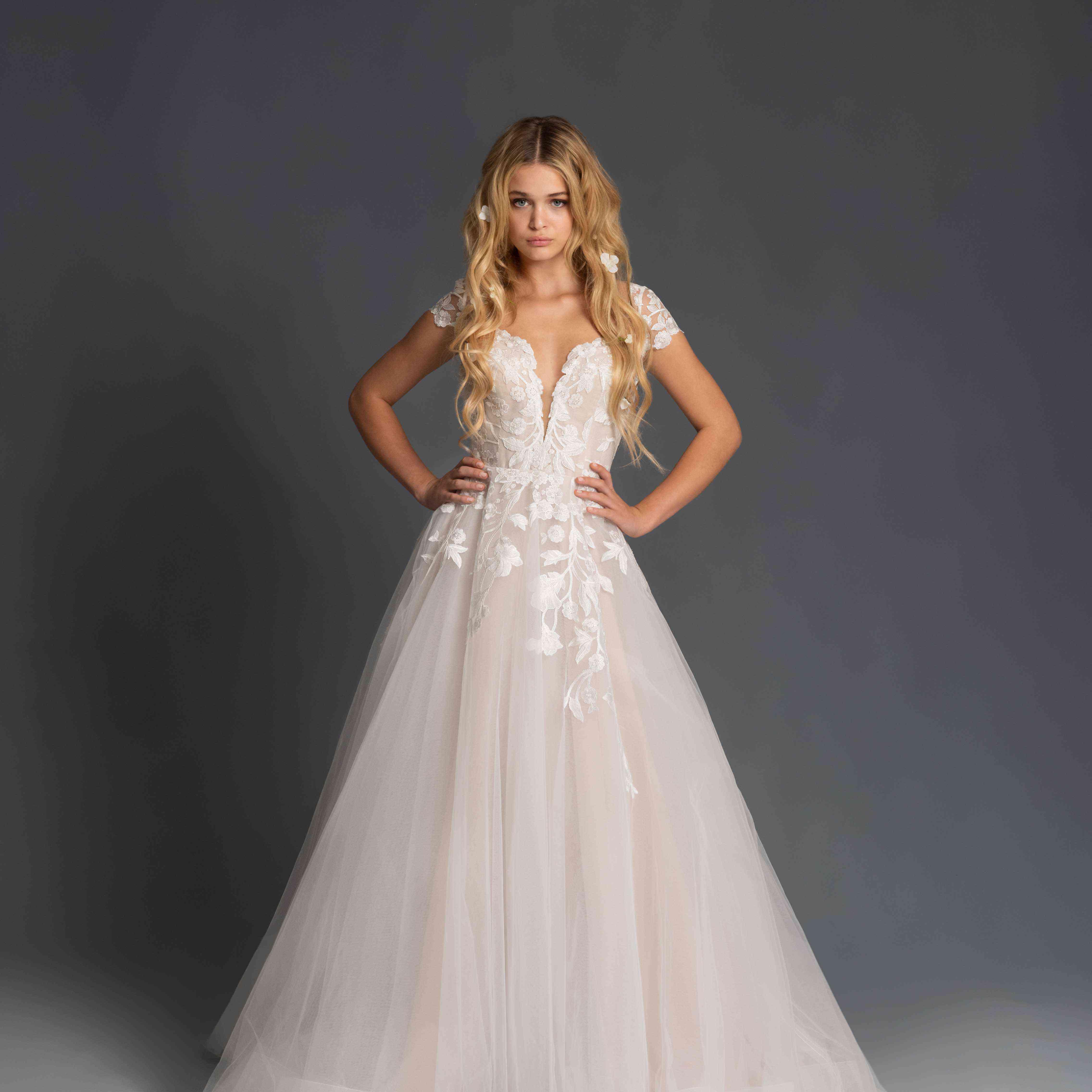 Model in cap sleeve A-line wedding dress