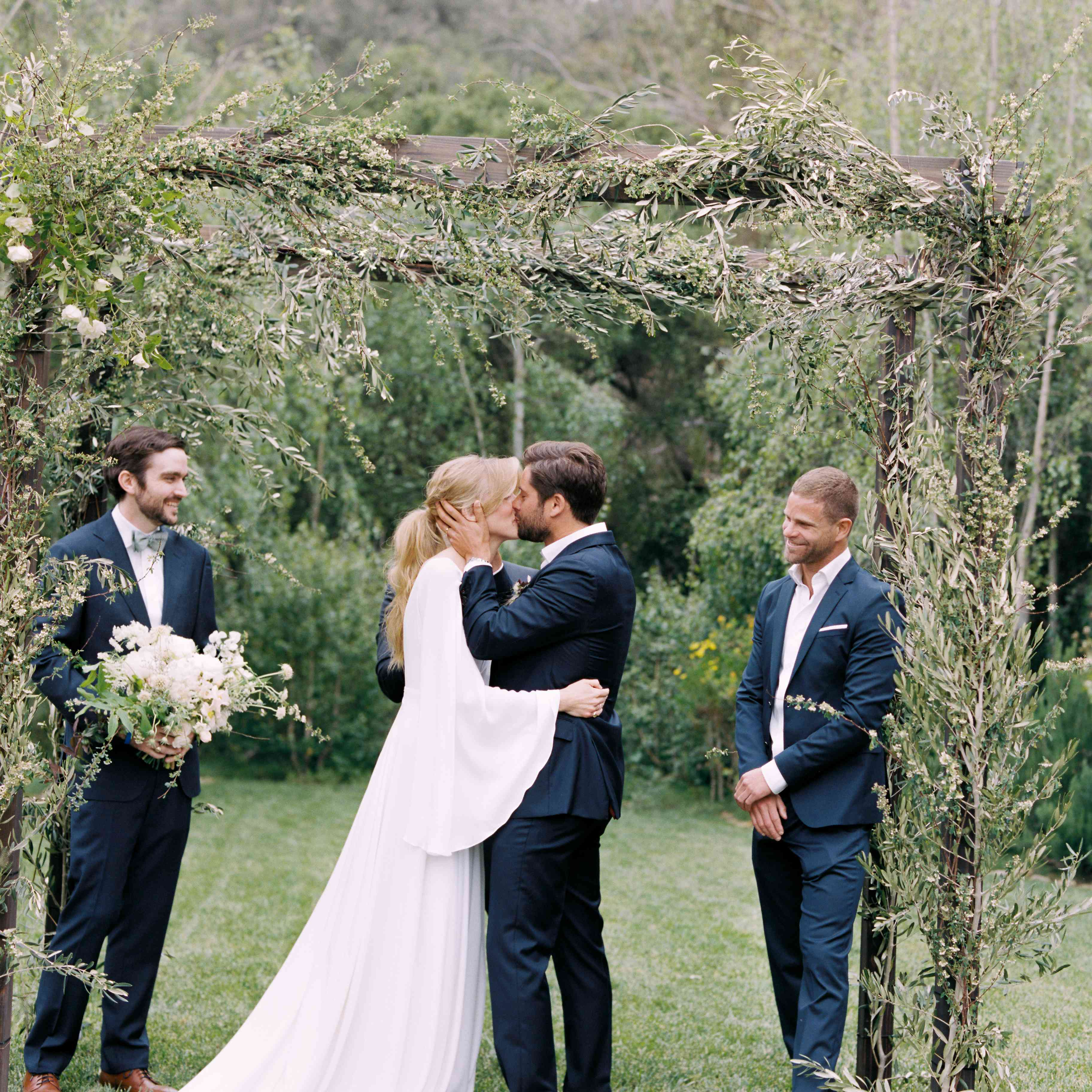 bride and groom kissing ceremony